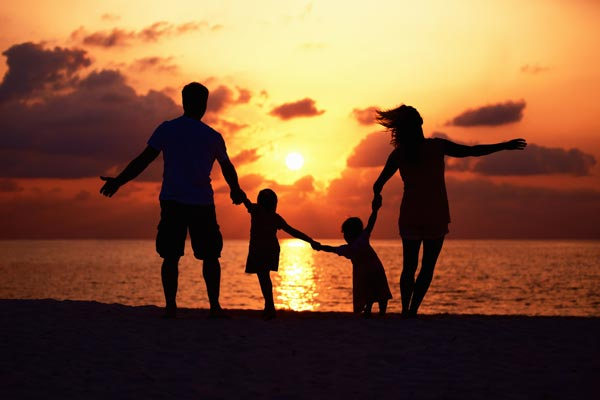 Loving Family Having Fun on Beach at Sunset