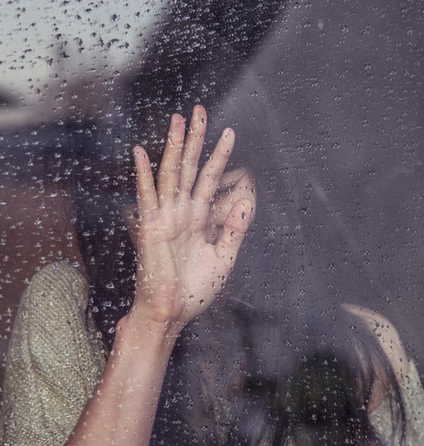 Rain Window Hand Blur